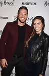 CULVER CITY, CA - OCTOBER 21: Actor Brett Zimmerman (L) and actress Courtney Turk attend the Dorit Kemsley Hosts Preview Event For Beverly Beach By Dorit at the Trunk Club on October 21, 2017 in Culver City, California.