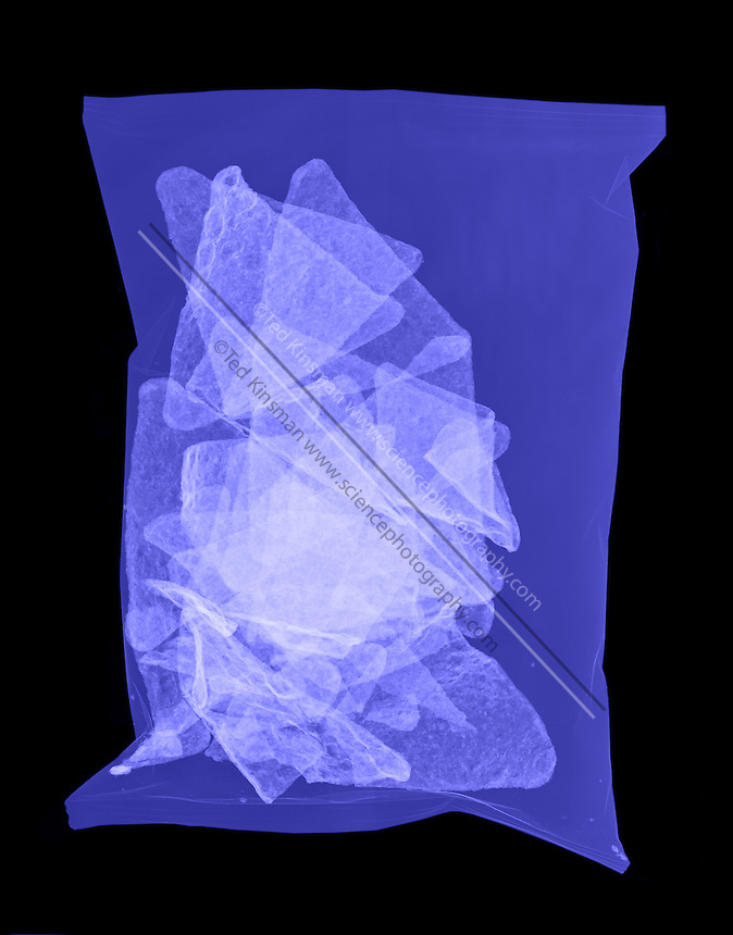 An X-ray of a bag of corn chips.  These are a common snack food.