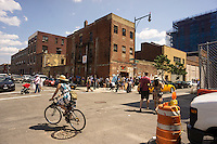 Crowds attracted to the Rockaway Brewery in Western Queens in the neighborhood of Long Island City in New York seen on Saturday, June 15, 2013. The formerly industrial waterfront is experiencing heavy development partially because of it's proximity to Manhattan . (© Richard B. Levine)