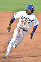 Devan Ahart (6) of the Ogden Raptors hustles towards third base against the Grand Junction Rockies during Opening Night of the Pioneer League Season on June 16, 2014 at Lindquist Field in Ogden, Utah. (Stephen Smith/Four Seam Images)