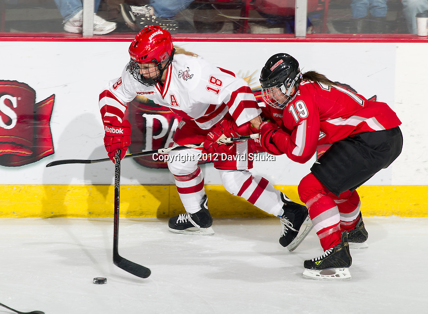 Wisconsin Badgers Brianna Decker (18) battles for the puck against Ohio State Buckeyes Danielle Gagne (19) during a WCHA Conference NCAA college women's hockey game on Saturday, February 18, 2012 in Madison, Wisconsin. Ohio State won 4-2. (Photo by David Stluka)