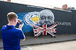 Leicester's fans pose in front of the mural before the Barclays Premier League match at the King Power Stadium.  Photo credit should read: David Klein/Sportimage