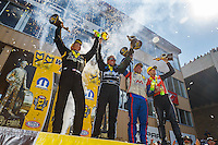 Jul 24, 2016; Morrison, CO, USA; (From left) NHRA top fuel driver Tony Schumacher , funny car driver John Force , pro stock driver Allen Johnson and pro stock motorcycle rider Andrew Hines celebrate after winning the Mile High Nationals at Bandimere Speedway. Mandatory Credit: Mark J. Rebilas-USA TODAY Sports