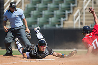 Austin Bossart (17) of the Lakewood BlueClaws beats the tag attempt by Kannapolis Intimidators catcher Daniel Gonzalez (8) as home plate umpire David Martinez looks on at Kannapolis Intimidators Stadium on May 8, 2016 in Kannapolis, North Carolina.  The Intimidators defeated the BlueClaws 3-2.  (Brian Westerholt/Four Seam Images)