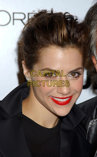 "BRITTANY MURPH.During ""Just Cavalli"" Flaunt Magazine's 6 Year Anniversary Party and Holiday Toy Drive to benefit Para Los Ninos held at a private residence in Los Angeles, California, USA, December 10th 2004..portrait headshot brunette red lipstick.Ref: ADM.www.capitalpictures.com.sales@capitalpictures.com.©Laura Farr/AdMedia/Capital Pictures ."