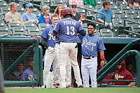 Frisco RoughRiders Juremi Profar (13) celebrates with teammates, including Elvis Andrus (1), after hitting a home run during a Texas League game against the Midland RockHounds on May 21, 2019 at Dr Pepper Ballpark in Frisco, Texas.  (Mike Augustin/Four Seam Images)