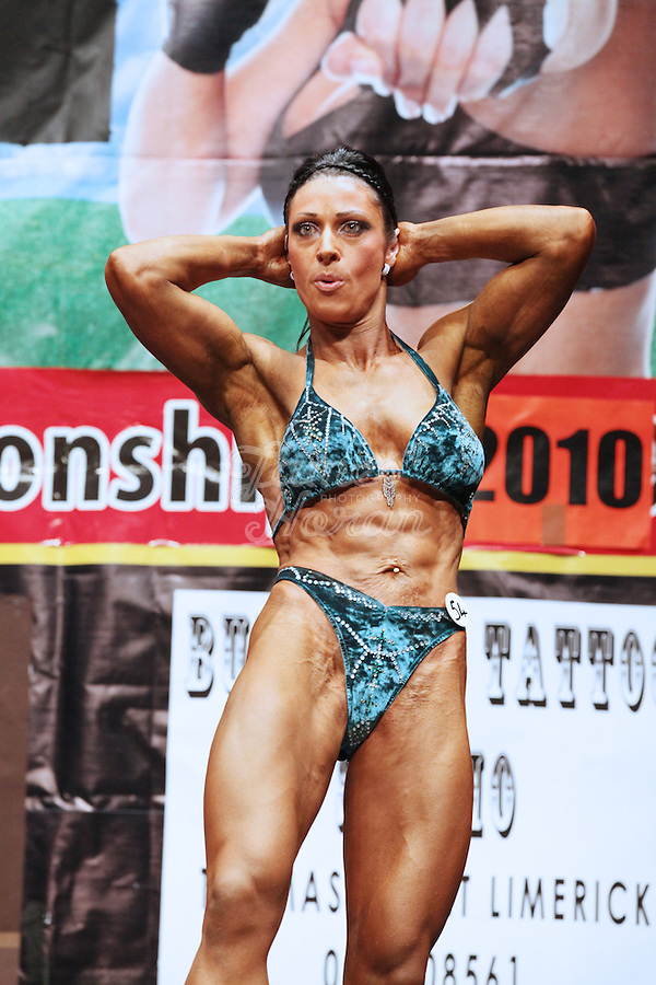23/10/2010. Irish female physique and figure fitness national championships.  Sophia Mc Namara (1st place winner) from Limerick is pictured posing onstage during the female physique category as part of the RIBBF national bodybuilding championships at the University of Limerick Concert Hall, Limerick, Ireland. Picture James Horan.