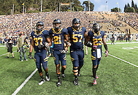 California captains Robert Mullins, Keenan Allen, Brian Schwenke and Josh Hill walk on the field for coin toss ceremony before 115th Big Game against Stanford at Memorial Stadium in Berkeley, California on October 20th, 2012.  Stanford defeated California, 21-3.