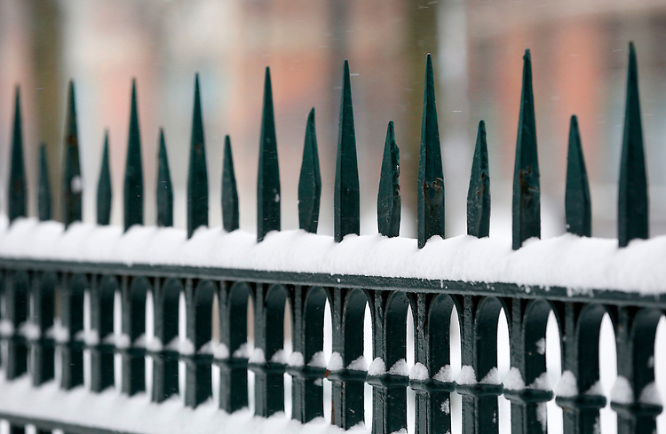 Snow collects on fences along the Lincoln Park campus of DePaul University in Chicago as the New Year brought two days of lake effect snow and ice. (Photo by Jamie Moncrief)