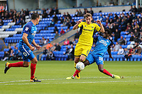 Ryan Ledson of Oxford United (centre) is fouled on the edge of the box by Leo Da Silva Lopes of Peterborough United (right) during the Sky Bet League 1 match between Peterborough and Oxford United at the ABAX Stadium, London Road, Peterborough, England on 30 September 2017. Photo by David Horn.
