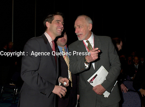 March 19 2003, Montreal, Quebec, Canada<br /> <br />   Andre Boisclair, Quebec's Environment Minister(L) and Martin Dusseault, President of Reseau Environement (M)and<br /> David Anderson,Canada's  Environment Minister, (R )jokes while arriving for  the  opening plenary session of Americana, a 3 days conference and  trade show on environment and waste management organized by Reseau Environnement, March 19, 2003 in Montreal, Canada.<br /> <br /> Photo :   Pierre Roussel / AGENCE QUEBEC PRESSE
