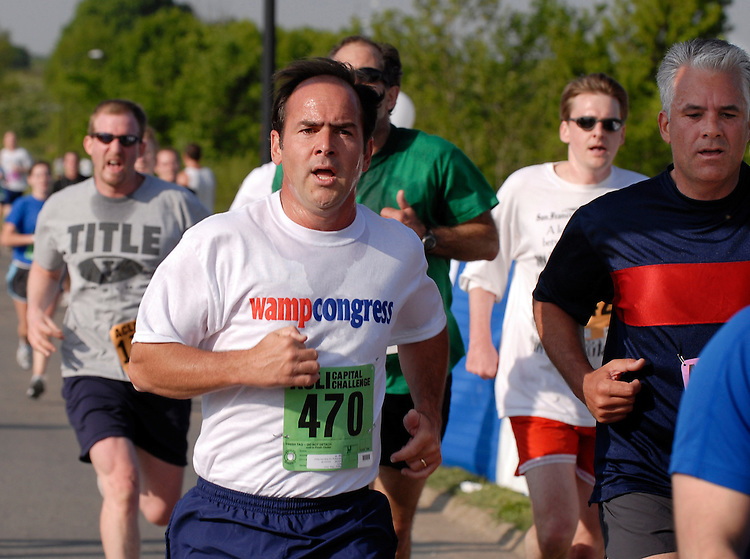 Rep. Zach Wamp, R-Tenn., left, and Sen. John Ensign, R-Nev., right, finish the 25th annual ACLI Capital Challenge 3 mile race in Anacostia Park.