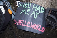 """A protest sign reading """">You had me at / >HELLOWORLD"""" lays against a tree during the March for Science demonstration on Sat., April 22, 2017. """"Hello World"""" and its variants are often the first things printed on a computer screen when learning a new computer language."""