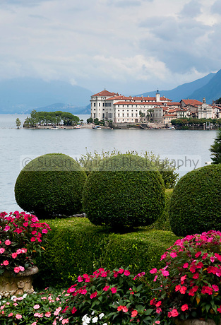 View to Isola Bella and the Borromeo Palace from the gardens of Villa Palazzo Aminta Hotel, Stresa, Lago Maggiore, Italy