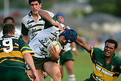 S. Savea is scragged from behind by S. Saravanua. Counties Manukau Premier Club Rugby, Pukekohe v Manurewa  played at the Colin Lawrie field, on the 17th of April 2006. Manurewa won 20 - 18.