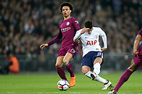 Erik Lamela of Tottenham Hotspur and Leroy Sane of Manchester City during Tottenham Hotspur vs Manchester City, Premier League Football at Wembley Stadium on 14th April 2018