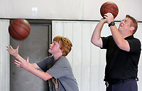 NWA Democrat-Gazette/DAVID GOTTSCHALK  Officer Tommy Wright, with the Springdale Police Department, plays an elimination basketball game with Michael Jones, 13, Tuesday, June 13, 2017, at Jones Elementary School in Springdale. Students are participating in the department's Sandlot Program that enables school resource officers to play, hangout and participate in different activities with school age students at the different school's in the district. The students also participate in the Free Summer Lunch Program through Springdale Public Schools. This week officers are at Bayyari, Elmdale and Jones Elementary School.