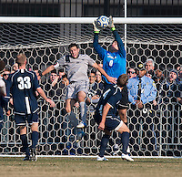 Tommy Muller (8) of Georgetown goes up for the ball with Drew Ilijevski (0) of San Diego during the game at North Kehoe Field in Washington, DC.  Georgetown defeated San Diego, 3-1.