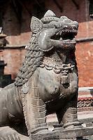 Nepal, Patan.  Guardian Lion Statue.