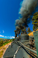 Steam locomotive pulling the Cumbres & Toltec Scenic Railroad train on the 64 mile run between Antonito, Colorado and Chama, New Mexico. The railroad is the highest and longest narrow gauge steam railroad in the United States with a track length of 64 miles. The train traverses the border between Colorado and New Mexico, crossing back and forth between the two states 11 times. The narrow gauge track is 3 feet wide. It runs over 10,015 ft (3,053 m) Cumbres Pass.