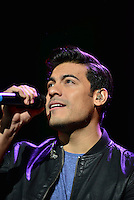 MIAMI, FL - OCTOBER 09: Carlos Rivera performs during Sin Bandera Tour In Miami at American Airlines Arena on October 9, 2016 in Miami, Florida. Credit: MPI10 / MediaPunch