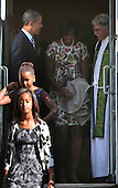 The First Family talks with Reverend Luis Leon after church service at St John's Episcopal Church on Sunday, September 19, 2010. From left to right: Malia and Sasha Obama, United States President Barack Obama, First Lady Michelle Obama, and Reverend Luis Leon. .Credit: Dennis Brack / Pool via CNP
