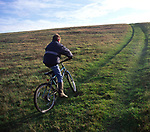 ARM486 Child on country bike ride Burrow Hill Butley Suffolk England