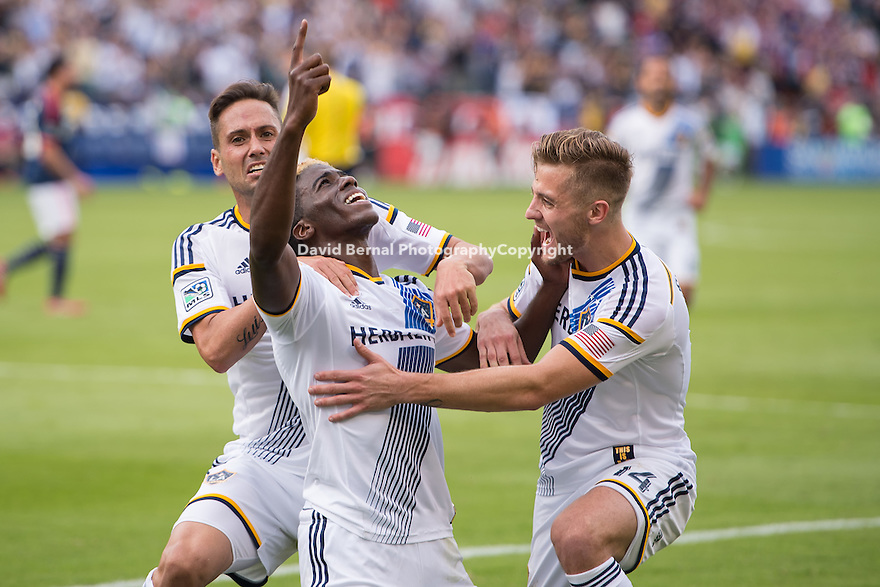 CARSON, CA - December 7, 2014: LA Galaxy teammates, Marcelo Sarvas, Gyasi Zardes, and Robbie Rogers celebrate Zardes's goal. The MLS Cup. LA Galaxy vs New England Revolution match at the StubHub Center in Carson, California. Final score, LA Galaxy 2, New England Revolution 1 (2 OT).