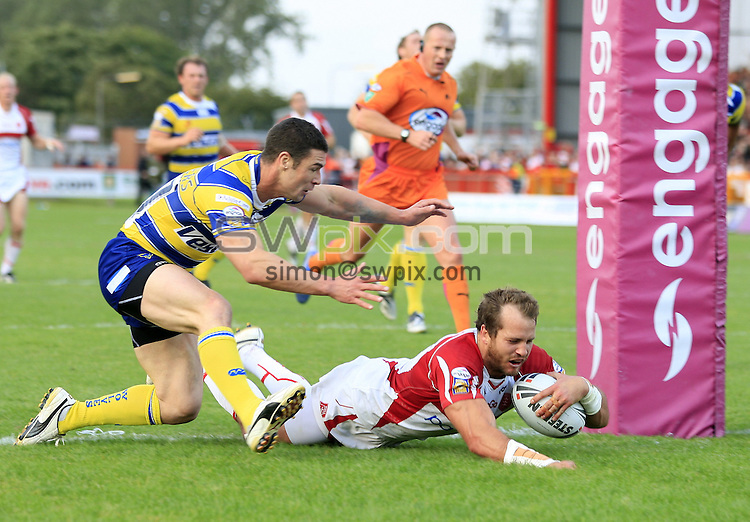 Pix: Chris Mangnall/SWpix.com, Rugby League, Super League. 05/09/09 Hull K R v Warrington Wolves....picture copyright>>Simon Wilkinson>>07811267 706>>....Hull's Clint Newton scores robins 3rd Try    Warrington's Richie Mathers couldn't stop him