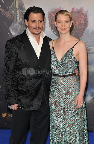 Johnny Depp &amp; Mia Wasikowska at the &quot;Alice Through The Looking Glass&quot; European film premiere, Odeon Leicester Square cinema, Leicester Square, London, England, UK, on Tuesday 10 May 2016.<br /> CAP/CAN<br /> &copy;CAN/Capital Pictures /MediaPunch ***NORTH AMERICA AND SOUTH AMERICA ONLY***