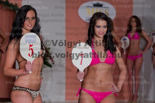 Lilla Szandra Gajdacs (L) and Antonia Csehi (R) participate the Miss Hungary beauty contest held in Budapest, Hungary on December 29, 2011. ATTILA VOLGYI