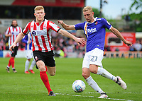 Lincoln City's Elliott Whitehouse vies for possession with Exeter City's Dean Moxey<br /> <br /> Photographer Andrew Vaughan/CameraSport<br /> <br /> The EFL Sky Bet League Two Play Off First Leg - Lincoln City v Exeter City - Saturday 12th May 2018 - Sincil Bank - Lincoln<br /> <br /> World Copyright &copy; 2018 CameraSport. All rights reserved. 43 Linden Ave. Countesthorpe. Leicester. England. LE8 5PG - Tel: +44 (0) 116 277 4147 - admin@camerasport.com - www.camerasport.com