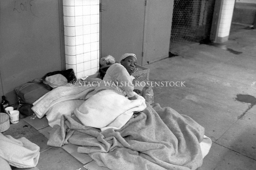 (021207-SWR02.jpg) New York, NY - CIrca 1988 -- A homeless woman in her make-shift bed, in the 34th Street Eighth Avenue Subway Station near Pennsylvania Station.. Stacy Walsh Rosenstock