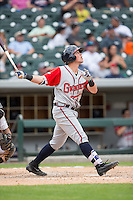 Blake Lalli (15) of the Gwinnett Braves follows through on his swing against the Charlotte Knights at BB&T BallPark on May 22, 2016 in Charlotte, North Carolina.  The Knights defeated the Braves 9-8 in 11 innings.  (Brian Westerholt/Four Seam Images)