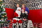 Santa and hard working elf Maire Murphy pictured with Margaret O'Sullivan and Kathleen Murphy at the Deenagh Lodge runned by Kerry Down Syndrome.