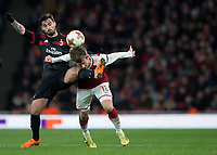 Suso of AC Milan kicks Nacho Monreal of Arsenal in the face during the UEFA Europa League round of 16 2nd leg match between Arsenal and AC Milan at the Emirates Stadium, London, England on 15 March 2018. Photo by Vince  Mignott / PRiME Media Images.