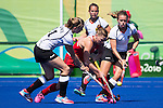 Katelyn Falgowski #23 of United States is tackled by Franzisca Hauke #21 of Germany during USA vs Germany in a women's quarterfinal game at the Rio 2016 Olympics at the Olympic Hockey Centre in Rio de Janeiro, Brazil.