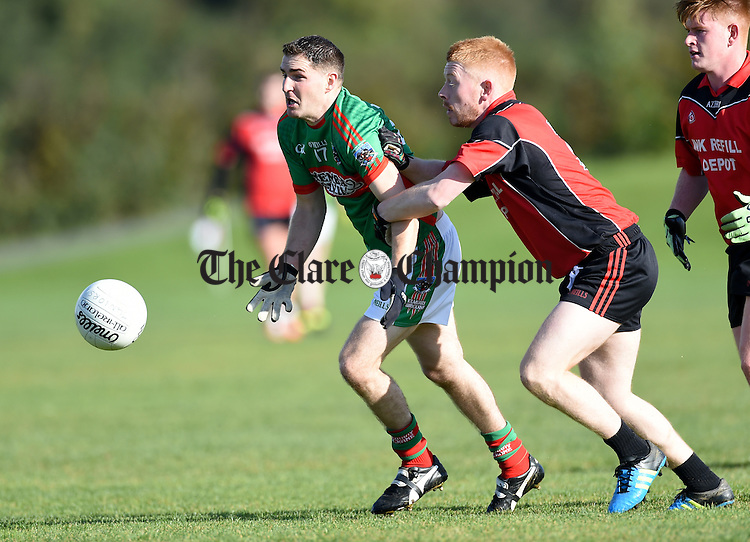 Pat Sexton of Kilmurry Ibrickane  in action against Adam Sherlock of Meelick during their Junior A  county final at Gurteen. Photograph by John Kelly.