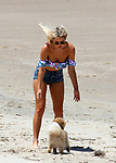 4JANUARY 2018 ILUKA NSW AUSTRALIA<br /> WWW.MATRIXPICTURES.COM.AU<br /> <br /> SPOILER ALERT! THE SECRET IS OUT!<br /> <br /> EXCLUSIVE PICTURES<br /> <br /> Keira Maguire pictured at Iluka Beach with Jarrod Woodgate and her dog Romeo. The hot new couple could hardly keep their hands off each other as they frolicked in the water and lazed in the sun. The pair were earlier sighted at Keira's family home near Yamba where its believed Keira introduced Jarrod to her family for the first time. <br /> <br /> Note: All editorial images subject to the following: For editorial use only. Additional clearance required for commercial, wireless, internet or promotional use.Images may not be altered or modified. Matrix Media Group makes no representations or warranties regarding names, trademarks or logos appearing in the images.