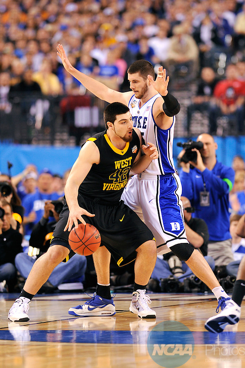 3 APR 2010: Deniz Kilicli (42) of West Virginia posts up in front of Brian Zoubek (55) of Duke during the semi final game between Duke and West Virginia at the Men's Final Four Basketball Championships held at Lucas Oil Stadium in Indianapolis, IN. Duke defeated West Virginia 78-57 to advance to the national championship. Ryan McKee/NCAA Photos