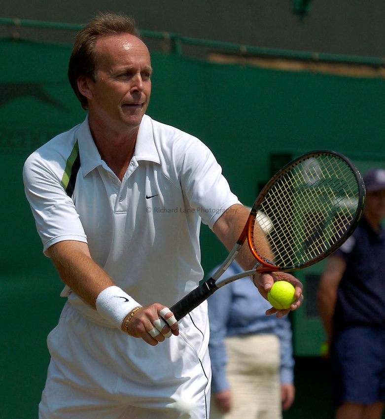 Photo: Richard Lane..Wimbledon Championships. 04/07/2006. .Great Britain's John Lloyd during an over 45 mens doubles match