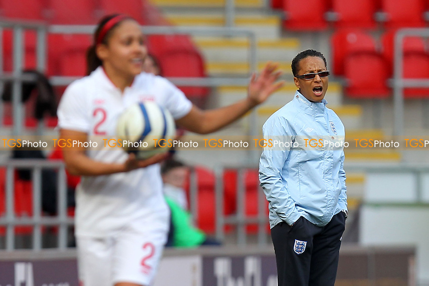 England manager Hope Powell looks on during the game - England Women vs Canada Women - International Football Friendly Match at the New York Stadium, Rotherham United FC - 07/04/13 - MANDATORY CREDIT: Gavin Ellis/TGSPHOTO - Self billing applies where appropriate - 0845 094 6026 - contact@tgsphoto.co.uk - NO UNPAID USE.