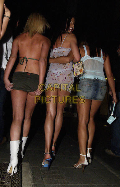RICARDO & FRIENDS.Leaving Embassy club,.London,.19th May 2004..full length full-length short purple flowery dress drag .www.capitalpictures.com.sales@capitalpictures.com.©Capital Pictures