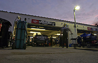 Work begins on Ryan Newman's car early on race morning.
