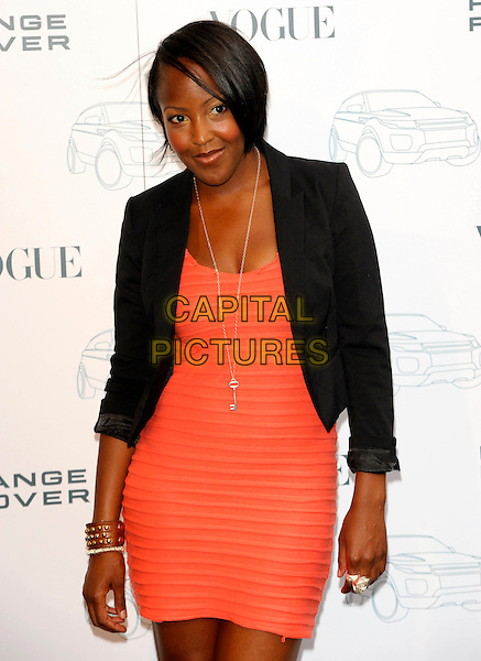 ANGELLICA BELL.Attends the Range Rover 40th Anniversary Party in association with Vogue at the Orangery, Kensington Palace, London, England, UK..July 1st 2010.half length black blazer jacket orange coral ribbed dress red cuff leather studs studded bracelet h anjellica anjelica angelica.CAP/CJ.©Chris Joseph/Capital Pictures.