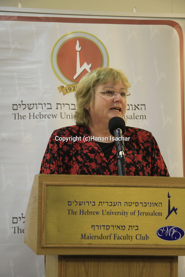 """Hebrew University of Jerusalem archaeologist Dr. Eilat Mazar announces the discovery of the """"Ophel Treasure"""", thirty six gold coins, gold and silver jewelry, and a 10cm gold medallion with the Jewish symbols of a Menorah, a Shofar and a Torah Scroll etched into it. The treasure from the 7th century, Byzantine period was found at the foot of Temple Mount"""
