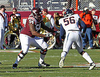 Nov 27, 2010; Charlottesville, VA, USA;  Virginia Tech Hokies offensive tackle Nick Becton (54) blocks Virginia Cavaliers defensive end Cam Johnson (56) during the game at Lane Stadium. Virginia Tech won 37-7. Mandatory Credit: Andrew Shurtleff