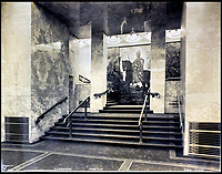 BNPS.co.uk (01202 558833)<br /> Pic:    CanterburyAuctionGalleries/BNPS<br /> <br /> The steps leading to the sliding door to the chapel in First Class decorated with a mounted Norman knight.<br /> <br /> Remarkable photos of the iconic ocean liner SS Normandie which was like a 'floating palace' have come to light over 80 years later.<br /> <br /> The giant 1,000ft long French passenger ship was the largest of her type in the world and won the coveted 'Blue Riband' for the fastest crossing of the Atlantic.<br /> <br /> English photographer Percy Byron's photos show the liner's luxurious 'Art Deco' interior with its chandeliers and pillars of Lalique glass.<br /> <br /> The vessel, which launched in 1935, even boasted its own swimming pool and a gym where young women can be seen doing aerobics while a man in a suit trains with a punch bag.