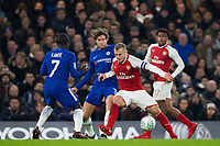 Arsenal's Jack Wilshere holds off the challenge from Chelsea's Marcos Alonso <br /> <br /> Photographer Craig Mercer/CameraSport<br /> <br /> The Carabao Cup - Semi-Final 1st Leg - Chelsea v Arsenal - Wednesday 10th January 2018 - Stamford Bridge - London<br />  <br /> World Copyright &copy; 2018 CameraSport. All rights reserved. 43 Linden Ave. Countesthorpe. Leicester. England. LE8 5PG - Tel: +44 (0) 116 277 4147 - admin@camerasport.com - www.camerasport.com