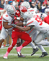 Ohio State Buckeyes linebacker Raekwon McMillan (5), Ohio State Buckeyes safety Vonn Bell (11) and Ohio State Buckeyes defensive lineman Tyquan Lewis (59) converge upon Indiana Hoosiers running back Devine Redding (34) for a stop in the third quarter at Memorial Stadium on October 3, 2015. (Chris Russell/Dispatch Photo)